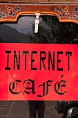 Close-up of internet cafe sign board at Bhutan