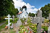 Graves in front of Wojnowo Church in Mikolajki, Warmia-Masuria, Poland