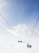 View of Titlis chair lift in fog at Uri Alps, Engelberg, Switzerland