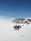 Tourist sitting on chairlift at Titlis in Uri Alps, Engelberg, Switzerland