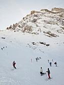 Skiers at the Joch Pass ski slope, Uri Alps, Titlis, Engelberg, Switzerland