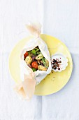 Summer vegetables in parchment paper with a dip
