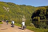 People cycling beside Saar loop in Mettlach, Saarland, Germany