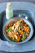 Fried noodles with carrots, mange tout and cashew nuts