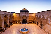 View of Sarihan caravanserai courtyard at dusk, Cappadocia, Turkey