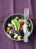 A bean medley with black beans, potatoes and avocado