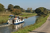 People travelling in ferry boat in Houilles Canal from Saarland, Germany
