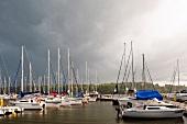 Boats moored at marina in Mikolajki, Warmia-Masuria, Poland