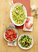 Orecchiette al pesto with a tomato salad and a broccoli medley