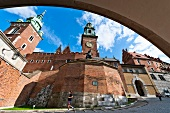 Low angle view of Wawel Royal Castle through arch, Krakow, Poland