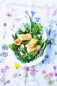 Asparagus strudel with a wild herb salad and quail's eggs