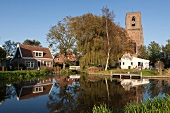 Picturesque of church and water in Ransdorp village, Noord, Amsterdam, Netherlands