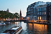 View of Munt Tower and canal houses in Amstel, Amsterdam, Netherlands, blurred motion