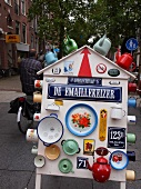Sign board of De Emaillekeizer with kettles and cups, De Pijp, Amsterdam, Netherlands