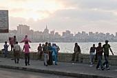 People at Corniche promenade in evening, Alexandria, Egypt
