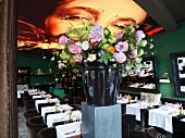 Flowers in pot and laid tables in Restaurant Red, Keizersgracht, Amsterdam, Netherlands