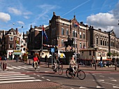 View of cyclists on street and Equestrian statue in Rokin Amsterdam, Netherlands