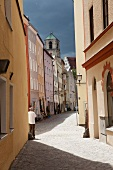 View of man standing at dyer alley in Wasserburg am Inn, Rosenheim, Germany