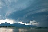 View of Chiemgau Alps, storm clouds and lake at Chiemgau, Bavaria, Germany