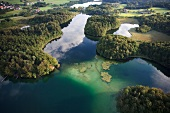 View of castle Hartmannsberg around Eggstatt Hemhofer Lake in Bavaria, Germany