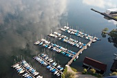 Aerial view of boats parked in port at Prienavera, Prien am Chiemsee, Bavaria, Germany