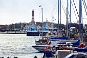 Lighthouse and boats in Hornumer port, Sylt, Germany