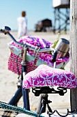Close-up of pink bicycle seat and saddle cover