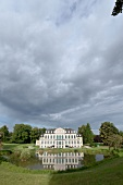View of pond in front of Wilhelmsthal Palace, Calden, Kassel, Hesse, Germany
