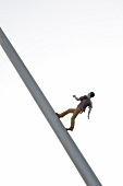 Close-up of Man walking to the sky sculpture, Kassel, Hesse, Germany