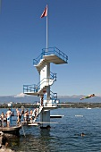 People diving in Lake Geneva, Switzerland