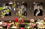 Photographs on wall with flowers in front at Restaurant Mani