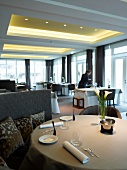 Waiters arranging table at dining restaurant La Mer, List, Sylt island, Germany