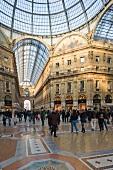 People shopping at Galleria Vittorio Emanuele II, Milan, Italy