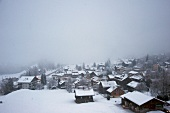 View of snow covered village at Chateau d'Oex, Riviera-Pays-d'Enhaut, Switzerland