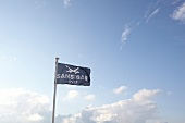 Flag of restaurant Zanaibar with sabre in Rantum, Sylt, Germany