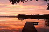 View of lake with jetty at dusk, Bradenburg, Germany