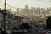View of Skyline and city streets with power cables in San Francisco, California, USA