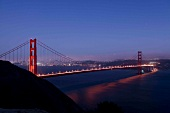 Illuminated Golden Gate Bridge at dusk, San Francisco, California, USA