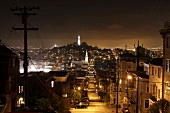 View of illuminated cityscape and street at night in San Francisco, California, USA