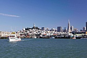 View of Fisherman's Wharf with cityscape and boat in San Francisco, California, USA