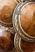 Close-up of traditional bowls for Kmelmilch in bazaar of Nizwa, Oman