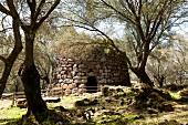 Stone fence of Santa Cristina sacred well in Paulilatino, Oristano, Sardinia, Italy
