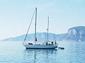 Sailing boat on Mediterranean Sea in Sardinia, Italy