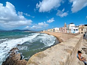 View of Mediterranean sea and city wall at Alghero, Sardinia, Italy