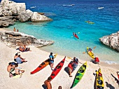 View of people and kayaks at Cala Mariolu, Gulf of Orosei, Sardinia, Italy