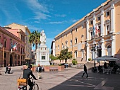 People in front of Piazza Ed 'Aborea in Oristano, Sardinia, Italy