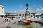 People at square near Rovinj harbor in Istria, Croatia