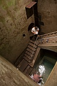 Two men in Mikveh in Archaeological Zone of Jewish Museum, Cologne, Germany