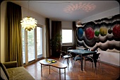 Interior of Hotel Chelsea with designer furniture and painted wall, Cologne, Germany