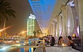 People dining at lounge in luxury Hotel Phoenicia, Beirut, Lebanon